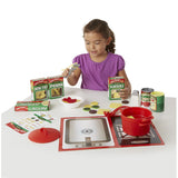 Melissa and Doug Pasta Play Food Set, girl playing with some contents unboxed
