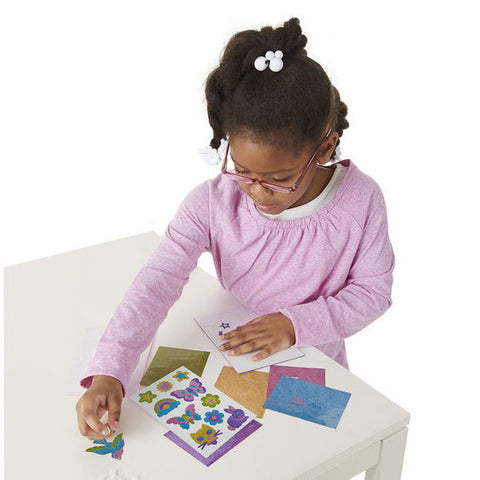 Mess free glitter friendship foam stickers girl playing with