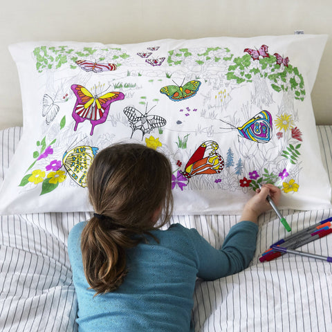 Doodle Butterfly Pillowcase, girl colouring with pens