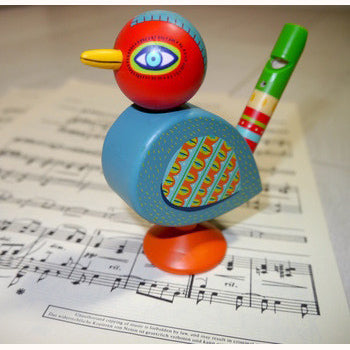Wooden Bird whistle, standing on sheet music