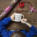 Doodle Mug and Pen Set, being drawn on by child