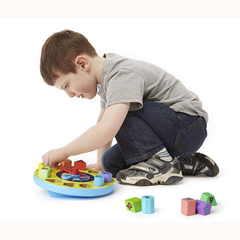 Chunky Shape Sorting Clock, with child removing some pieces
