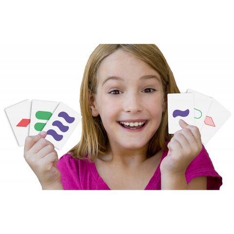 Set- the family game of visual perception, girl holding two sets up