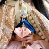 Queen Of The Castle Lottie Doll, unboxed held by child