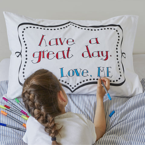 Doodle pillowcase, being drawn on by girl, frame side message