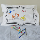 Doodle pillowcase and pens, frame side