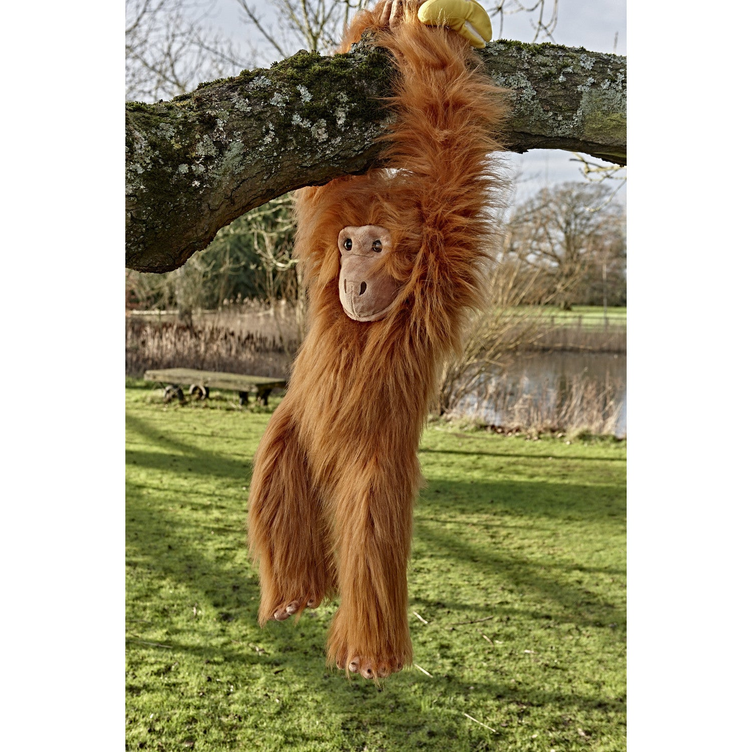 Orangutan Large Primate Puppet hanging from tree branch