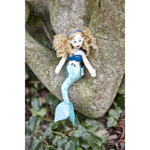 Mermaid (Light Skin Tone) Finger Puppet on statue with leaves