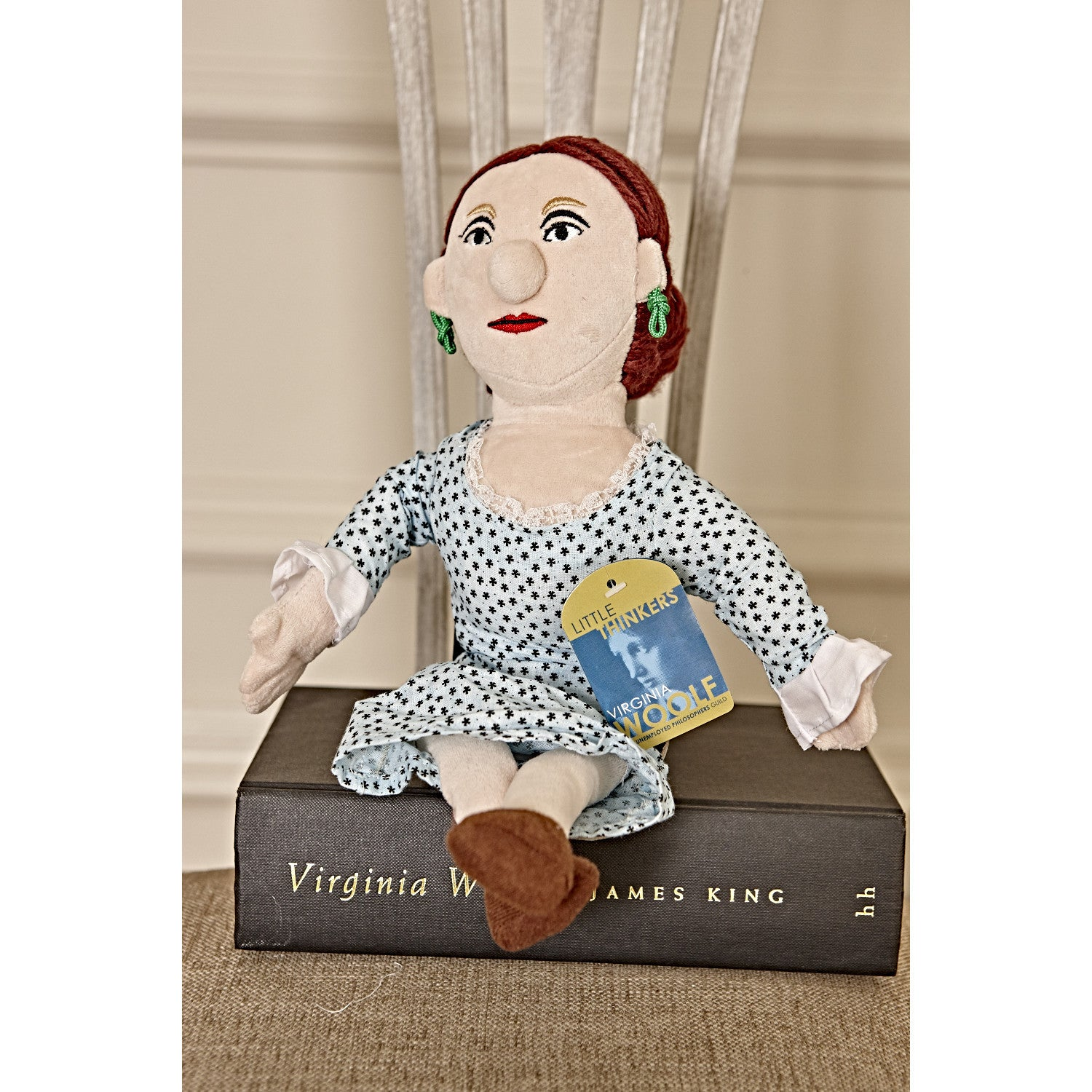 Virginia Woolf - Little Thinker Doll sitting on book