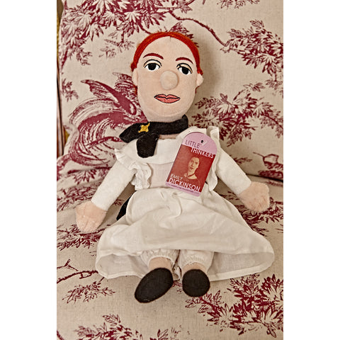 Emily Dickinson doll sat on a chair