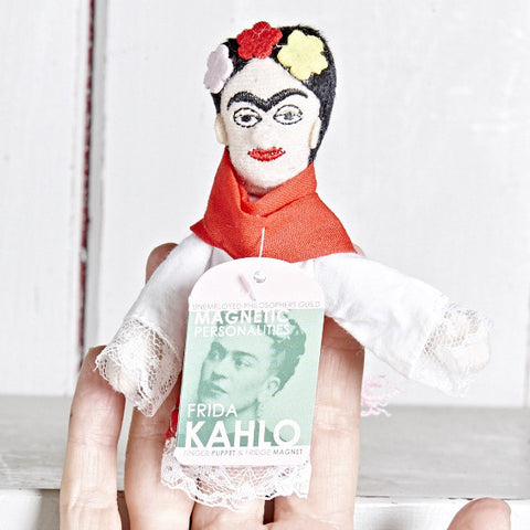 Frida Kahlo Finger Puppet on a finger