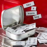 Little box of love tin opened displaying some of the magnetised words