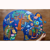Elephant Puzzle by Djeco, being completed, child's hand for scale