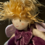 Ragtales Tooth Fairy doll purple, close up of face