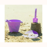 Scrunch Bucket - Purple, on beach with spade and frisbee