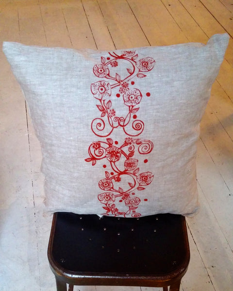 Linen pillow with red flower vine
