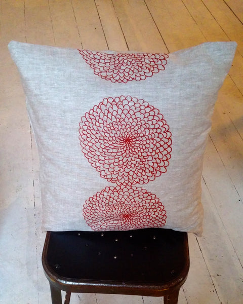 Linen pillow with red zinnia-ish flower