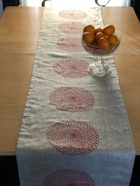 Table runner with red zinnia flower