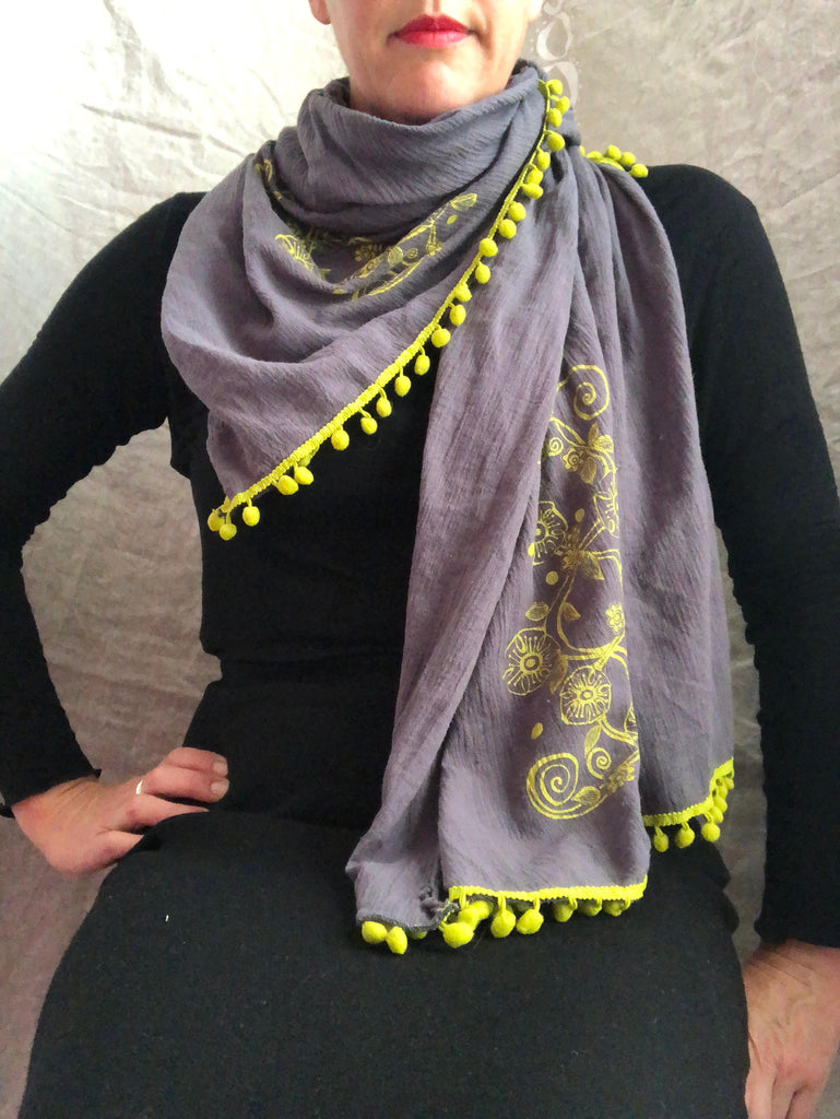 Slate gray scarf with chartreuse flower vine and pom poms