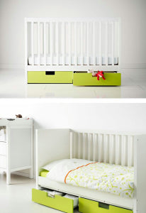 Large cot, later convert into a toddler bed by dropping one or both sides. Two storage drawers on wheels.