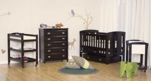 Standard cot, tall boy chest of drawers, changing station on wheels and a bassinet