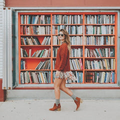 bohemian style bookcase and outfit