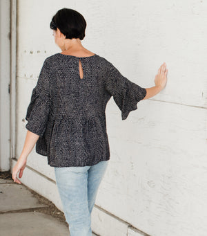 Spotted Peplum Top