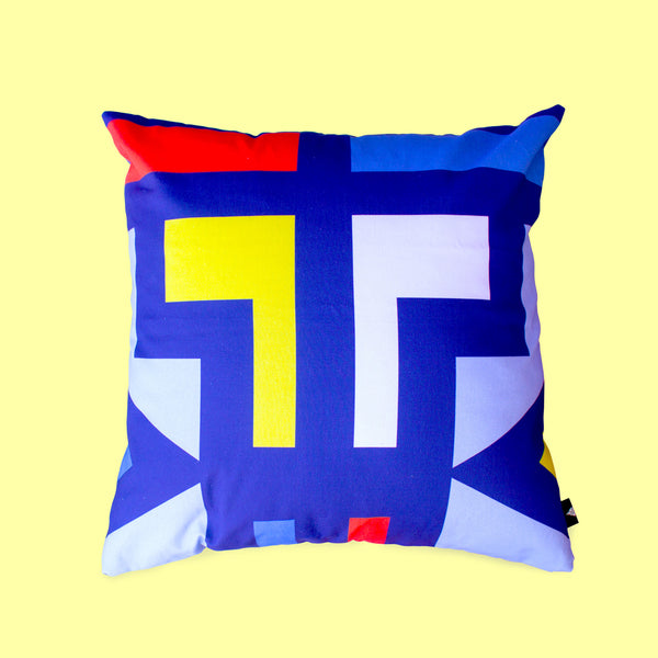 Ndebele Abstract scatter cushion with bright yellow, red, white and blue african bold pattern
