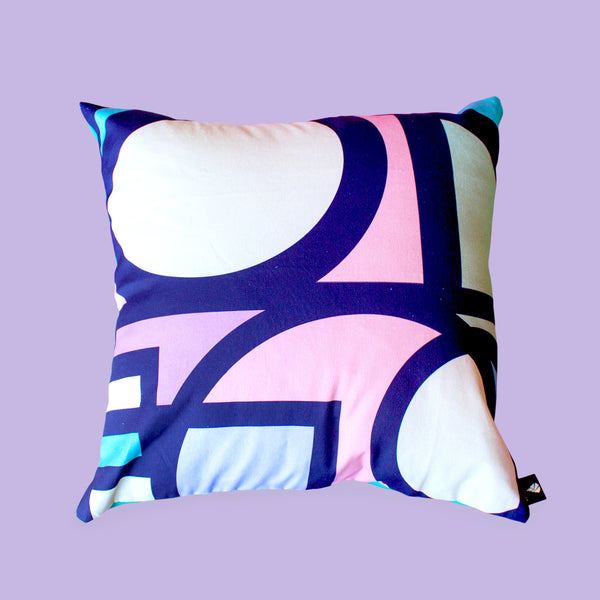 Circa stained glass art scatter cushion design with purple and pink accents