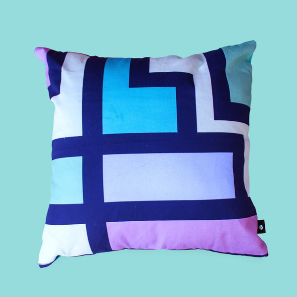 Stained glass grid scatter cushion that combines western and African shapes and patterns