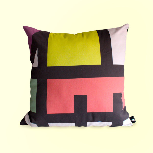 Colour blocked contemporary African scatter cushion with warm yellow, red and forest green accents