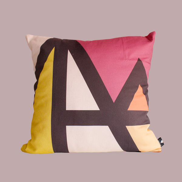 Rich African scatter cushion in bright colour blocked triangles in rich tones
