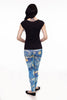 Back view of model wearing leggings with starry sky print