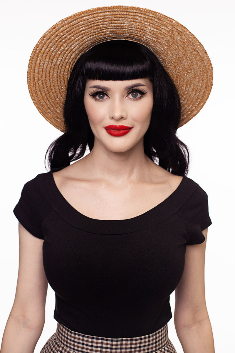 Model wearing black vintage top facing forward