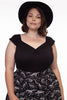 Plus size model wearing Isabel top in black