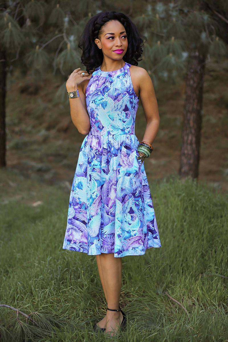 model wearing vintage style dress with unicorns on it