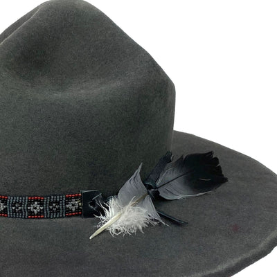hatWRKS original with beaded hatband with a pigeon feather