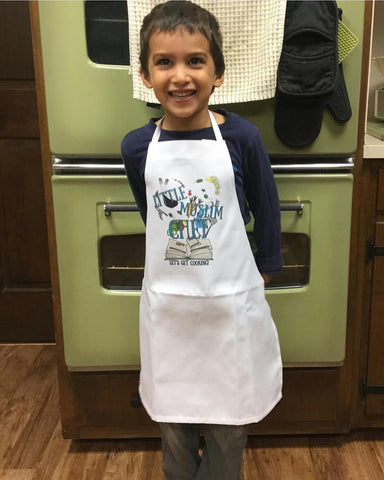 4 year old wearing Muslim Chef apron, tied at the neck.