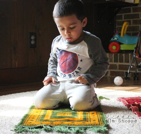 Toddler praying on prayer rug - 2.5 year old