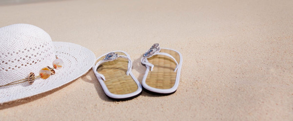 Beach wedding sandals and woven hat