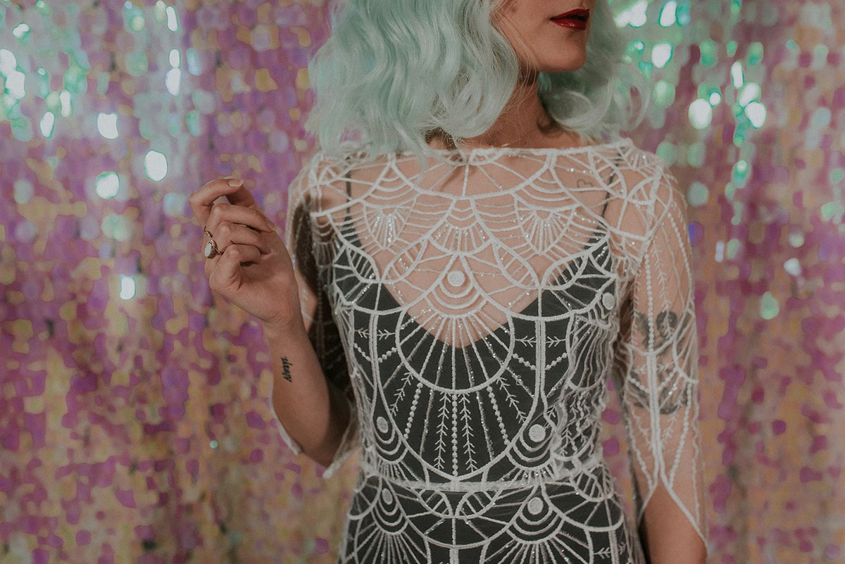 Close-up of a Great Gatsby inspired wedding dress with black slip dress- Lookbook