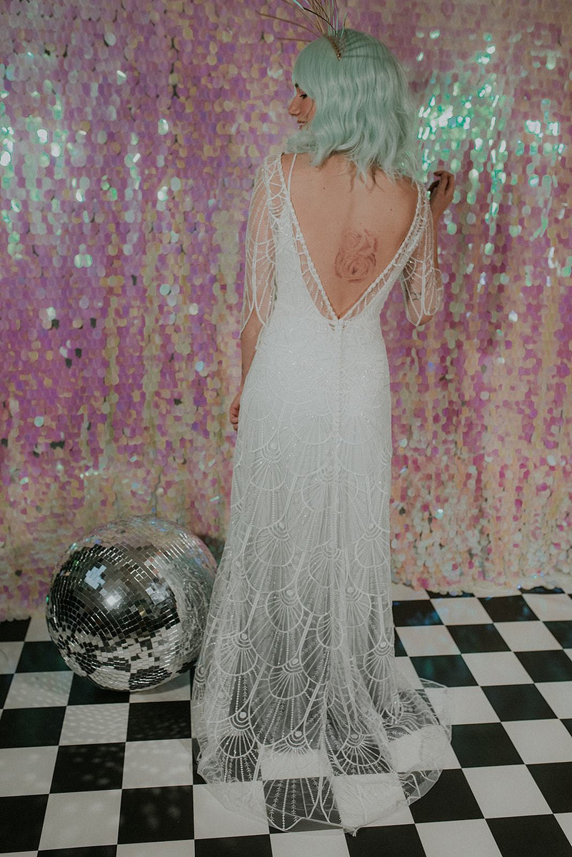 An elegant Bohemian wedding dress with a pink sequin back-drop - Lookbook