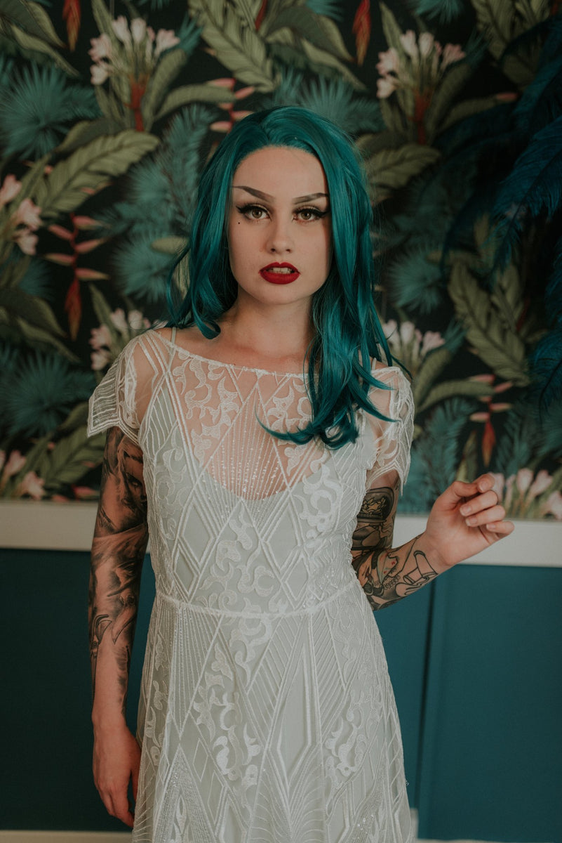 Elegant tattooed bride with light blue slip dress under our Labyrinth lace wedding dress - Lookbook