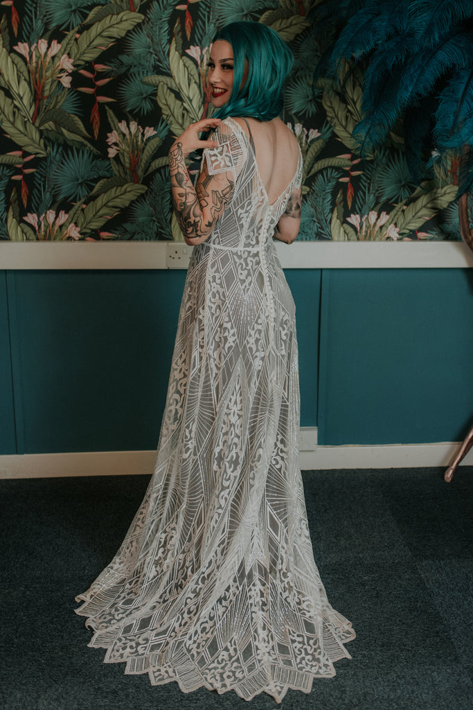 Bride wearing a wonderfully intricate lave wedding dress - Gallery