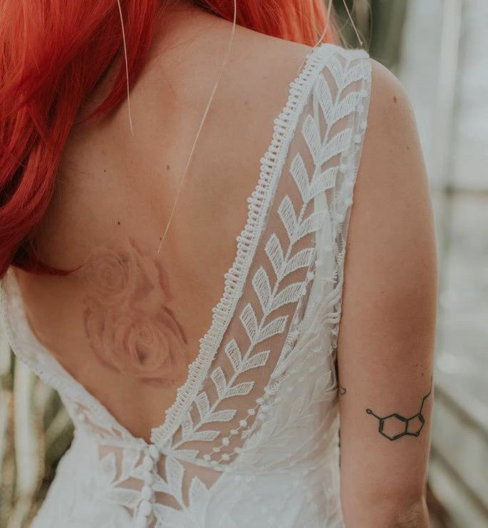 Beautiful close up of a backless lace wedding dress