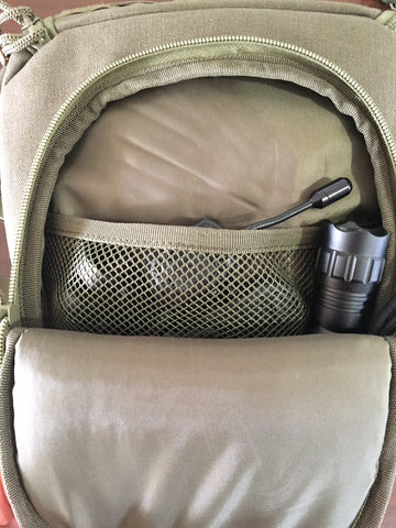 Mesh divider on front compartment of our ballistic helmet bag.