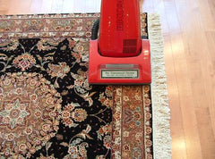 Vacuuming rugs
