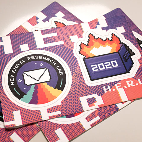 a stack of H.E.R.L. sticker sheets