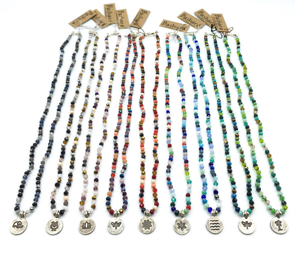 Hand Knotted delicate crystal necklace collection by jewelry designer Elly Bashara of Bozeman, Montana.  Colorful crystal mix necklaces with handmade Thai silver pendant - elephant, owl, lotus, dragonfly, sunflower, starflower, wave, palm tree