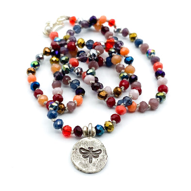 Elly Bashara designer from Bozeman, Montana handmade dragonfly pendant crystal necklace silver charm and clasp hand knotted on gray silk cord in metallic red and purple color mix